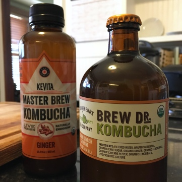Two bottles of store-bought kombucha